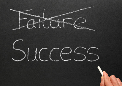 Crossing out failure and writing success.